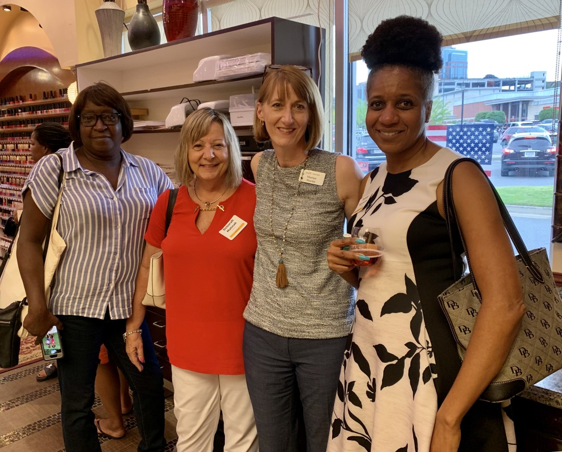 Attorney Marion Martin with clients at Swift Currie Client Appreciation Event